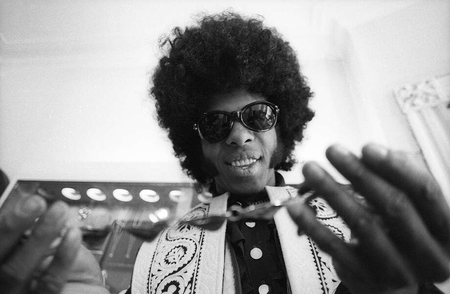 Sly Stone of the psychedelic soul group 'Sly And The Family Stone' tries on a necklace on March 9, 1969. Photo: Michael Ochs Archives, Getty Images / Michael Ochs Archives