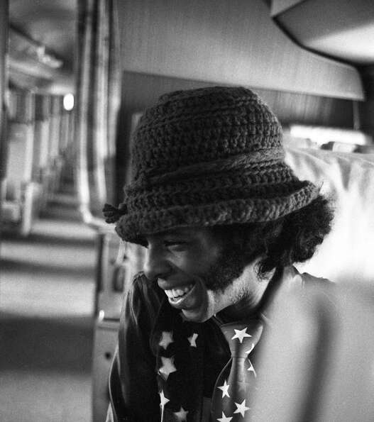 Sly Stone of the psychedelic soul group 'Sly and the Family Stone' sits aboard a plane in San Diego