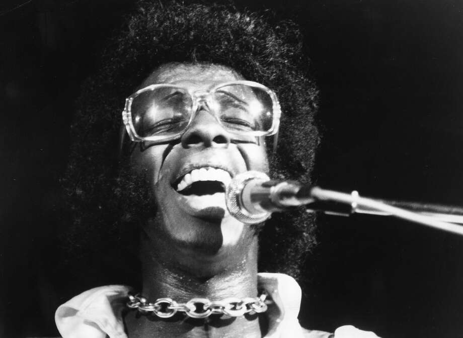 "Musician Sly Stone of the psychedelic soul group ""Sly And The Family Stone"" performs at the 1969 Woodstock Festival on August 17, 1969 in Bethel, New York. Photo: Michael Ochs Archives, Getty Images / Michael Ochs Archives"