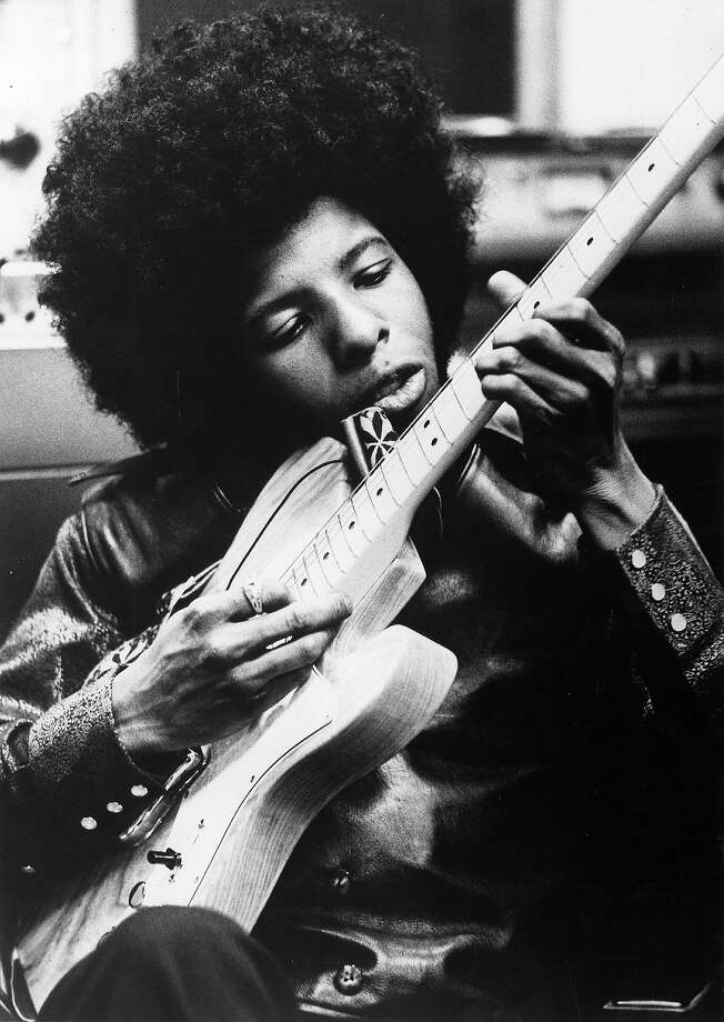 Sly Stone playing guitar. Photo: Michael Ochs Archives, Getty Images / Michael Ochs Archives