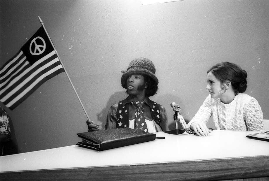Sly Stone doing a radio interview. Photo: Michael Ochs Archives, Getty Images / Michael Ochs Archives