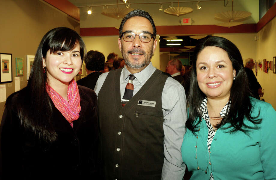 "OTS/HEIDBRINK - Zuani Villarreal, from left, Jon Hinojosa and Melissa Sorola at the Say Si ""Small Scale Work For A Larger Cause"" preview exhibit at Say Si on 2/28/2013. This is #1 of 4 photos. names checked photo by leland a. outz Photo: LELAND A. OUTZ, SPECIAL TO THE EXPRESS-NEWS / SAN ANTONIO EXPRESS-NEWS"