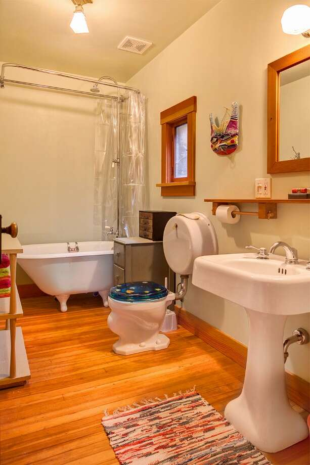 Bathroom of 14036 38th Ave. N.E. The 1,590-square-foot home, built in 1999, has one bedroom, one bathroom, exposed wood beams and ceilings, a finished daylight basement, a front porch, a wrap-around deck, a balcony, a patio and views of Lake Washington and the Cascades on a 10,225-square-foot lot. It's being sold with three other vacant view lots and is listed for $1.08 million. Photo: Courtesy Kelly And Kian Pornour/ Windermere Real Estate