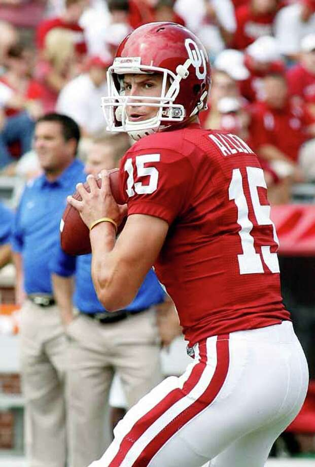 Oklahoma quarterback Drew Allen prepares to throw a pass against Tulsa. OU won 45-0. Photos by Ty Russell Photo: Ty Russell, COURTESY OKLAHOMA ATHLETICS / ©Ty Russell