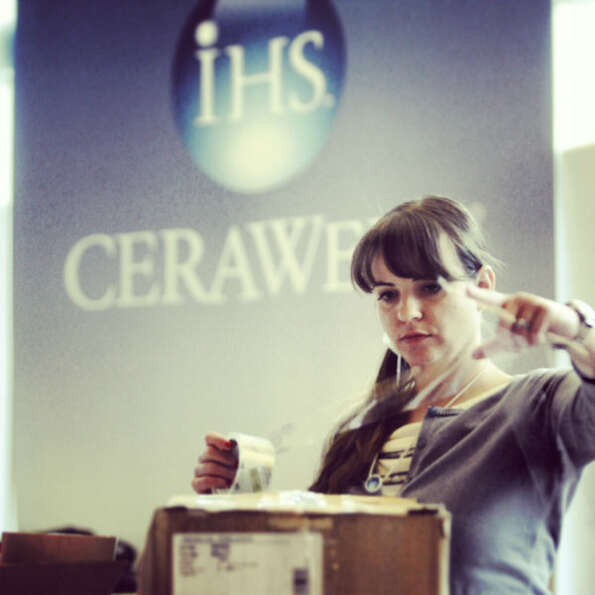 Kate Moscatel  begins to pack boxes on the last day of the IHS CERAWeek Thursday,  March 8, 2013 at