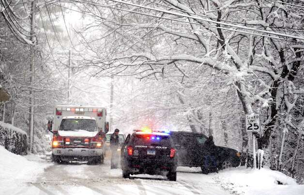 Police respond to a truck stuck on Platt Street in Ansonia, Conn. Friday, Mar. 8, 2013 as snow falls across the region. Photo: Autumn Driscoll