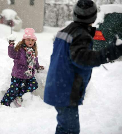 Olivia Leeney, 5, trades snowball throws with brother Anthony Leeney, 9, in their Ansonia, Conn. backyard Friday, Mar. 8, 2013 as snow falls across the region. Photo: Autumn Driscoll