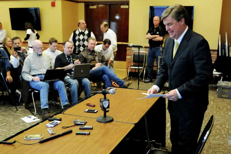 Colorado head coach Mike MacIntyre prepares to talk about his first recruiting class on signing day