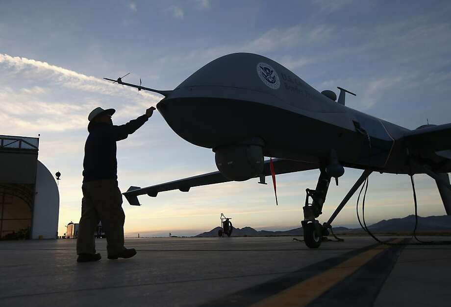 A Predator drone gets checked out before its surveillance flight near the Mexican border. Photo: John Moore, Getty Images