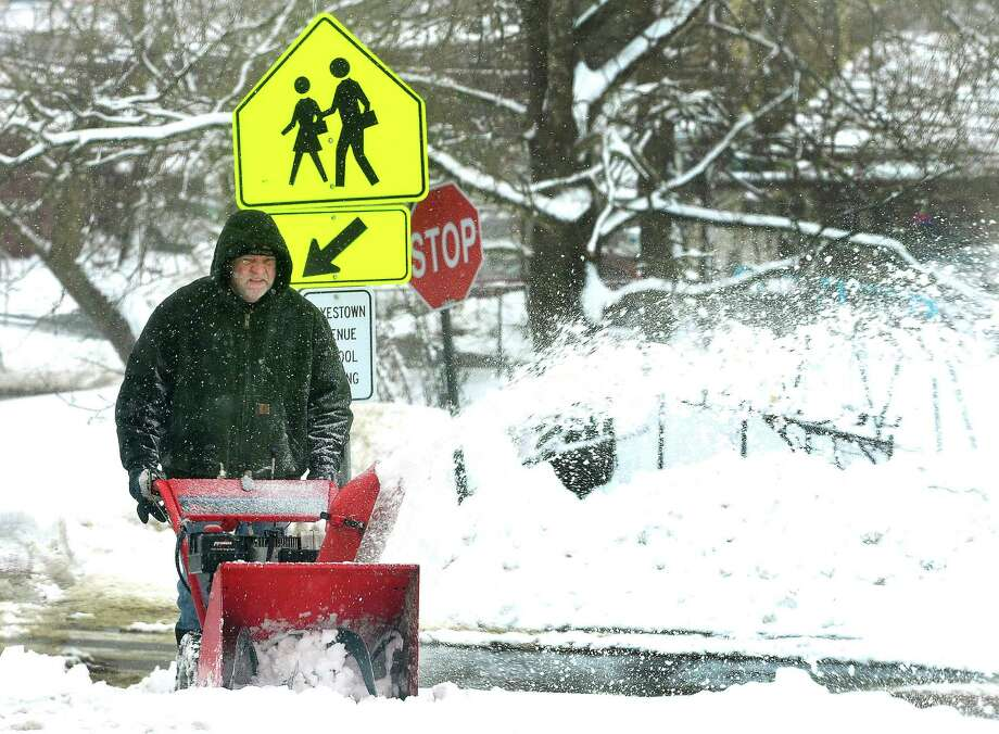 Custodian Mike Hogan clears the sidewalk in front of Hayestown School as Danbury digs out during Friday's snow, in Conn. March 8, 2013. Photo: Michael Duffy / The News-Times