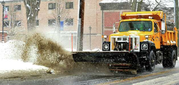 A city plow clears White Street as Danbury digs out during Friday's snow, in Conn. March 8, 2013. Photo: Michael Duffy / The News-Times