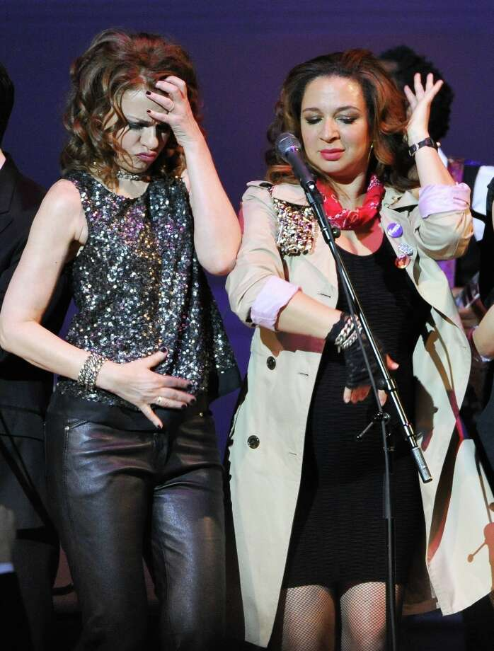 Actors Sandra Bernhard, left, and Maya Rudolph perform together during the encore at The Music of Prince tribute concert at Carnegie Hall on Thursday March 7, 2013 in New York. (Photo by Evan Agostini/Invision/AP) Photo: Evan Agostini, Associated Press / Invision