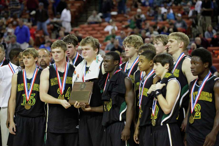 East Chambers basketball players pose for photographs with their semi-final award after a 69-50 loss against White Oak in Austin at the UIL State Basketball Championships in the Frank Erwin Center, Friday, March 8,  2013.  Valentino Mauricio/For The Enterprise Photo: Valentino Mauricio