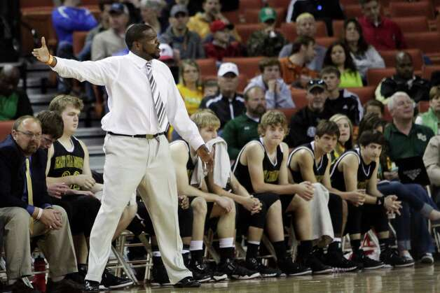 East Chambers  head coach Tramaine Hancock directs one of his players during their quarter final game at the UIL State Basketball Championships in Austin at the Frank Erwin Center, Friday, March 8,  2013.  Valentino Mauricio/For The Enterprise Photo: Valentino Mauricio