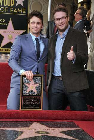 Actor James Franco, left, poses with Seth Rogen at a ceremony honoring Franco with a star on the Hollywood Walk of Fame on Thursday, March 7, 2013 in Los Angeles. Franco and Rogen starred together in the comedy Pineapple Express.  (Photo by John Shearer/Invision/AP) Photo: John Shearer, Associated Press / Invision