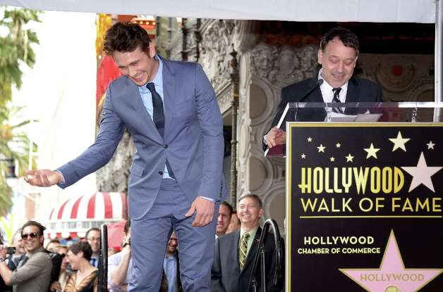Director Sam Raimi (R) speaks as actor James Franco is honored with a star on the Hollywood Walk of Fame on March 07, 2013 in Hollywood, California. AFP PHOTO/JOE KLAMAR Photo: JOE KLAMAR, AFP/Getty Images / AFP