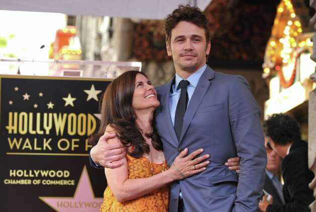 Actor James Franco, right, poses with his mother Betsy Franco at a ceremony honoring him with a star on the Hollywood Walk of Fame on Thursday, March 7, 2013 in Los Angeles. (Photo by John Shearer/Invision/AP) Photo: John Shearer, Associated Press / Invision
