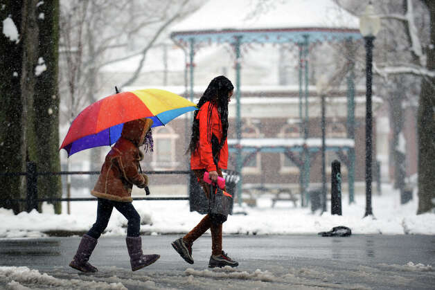 Rohjennae Harrison, left, walks in the snow with her cousin Jalailah Langston near Washington Park, in Bridgeport, Conn., March 18th, 2013. Photo: Ned Gerard / Connecticut Post