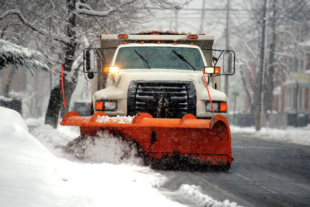A Public Works truck plows snow on Noble Ave., in Bridgeport, Conn., March 18th, 2013. Photo: Ned Gerard / Connecticut Post