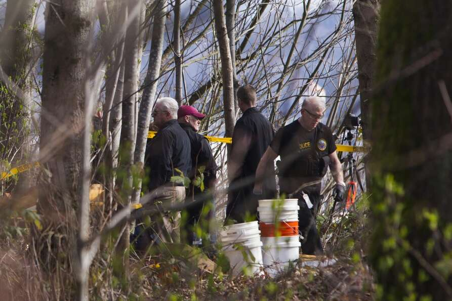 Detectives and CSI investigate a scene where a man reportedly found deceased remains Friday, March 8