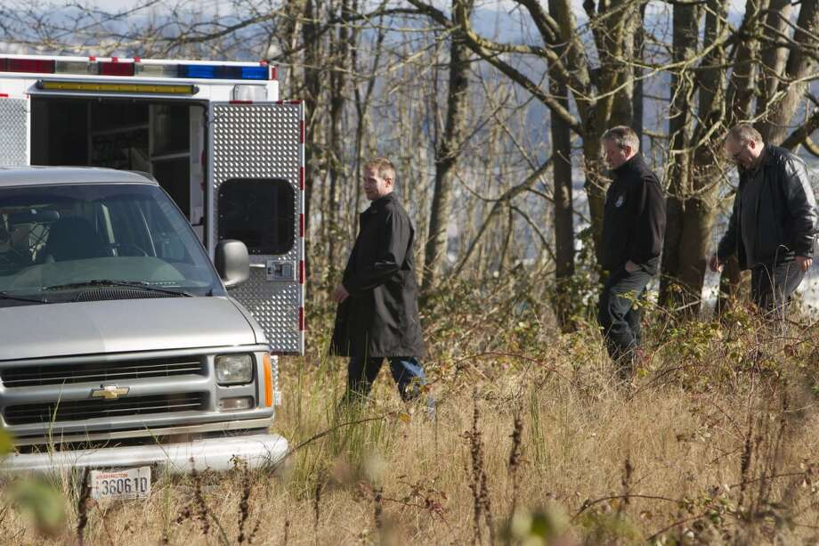 Detectives and CSI investigate a scene where a man reportedly found deceased remains Friday, March 8, 2013, on the 9800 block of Myers Way South in West Seattle. It is unknown as to if the remains are of human origin.