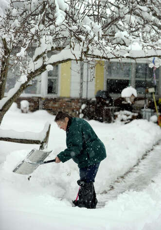 Barbara Oster,shovels the walk at her mother's home in Newtown after an overnight snowfall, Friday, March 8, 2013. Photo: Carol Kaliff / The News-Times