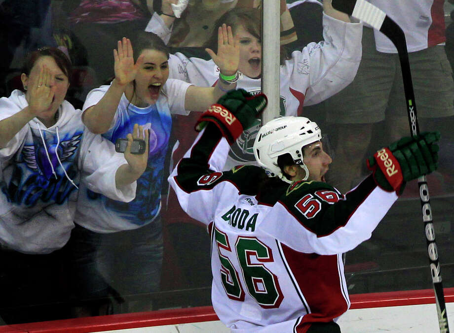 Ken Hoffman has a tip for watching hockey games on TV that involves looking for sticks in the air. Joel Broda celebrates after scoring a goal for the Houston Aeros at Toyota Center last year. Photo: Cody Duty, Staff / 2011 Houston Chronicle
