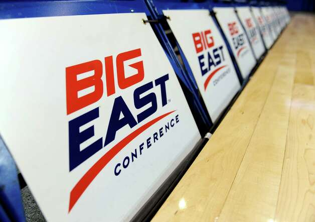 The logo for the Big East Conference is displayed on a row of courtside chairs at the Big East Conference women's basketball tournament in Hartford, Conn., Friday, March 8, 2013. The Big East has reached an agreement with seven departing basketball members that will allow them to separate from the football schools and create their own conference on July 1. Commissioner Mike Aresco told The Associated Press on Friday the seven Catholic schools that are leaving to form a basketball-centric conference will get the Big East name, along with the opportunity to play their league tournament in Madison Square Garden. (AP Photo/Jessica Hill) Photo: Jessica Hill, Associated Press / FR125654 AP