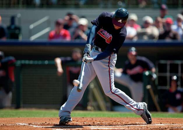Braves first baseman Freddie Freeman hits a 2-run home run during the first inning. Photo: Evan Vucci