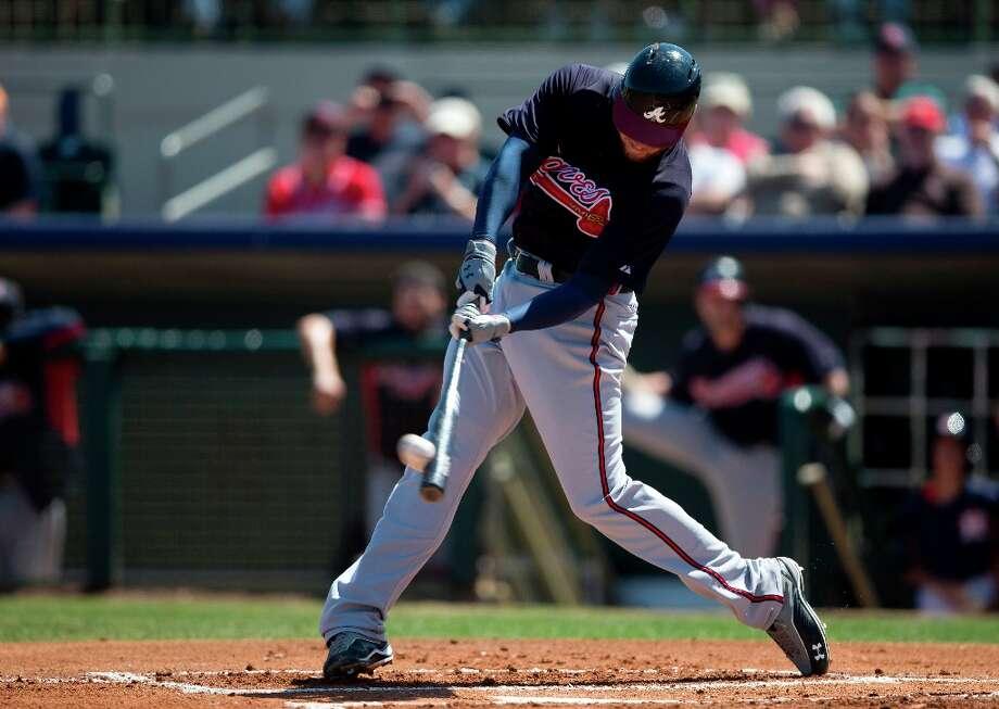 Braves first baseman Freddie Freeman hits a 2-run home run during the first inning. Photo: Evan Vucci