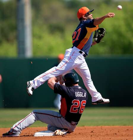 Braves' second baseman Dan Uggla slides into Astros second baseman Jose Altuve in an attempt to break up a double play during the first inning. Photo: Evan Vucci