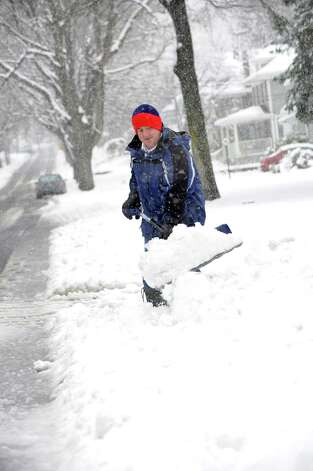 Chris Richetelli shovels the end of his driveway on Maple St. in Milford, Conn. on Friday March 8, 2013. Photo: Cathy Zuraw / Connecticut Post
