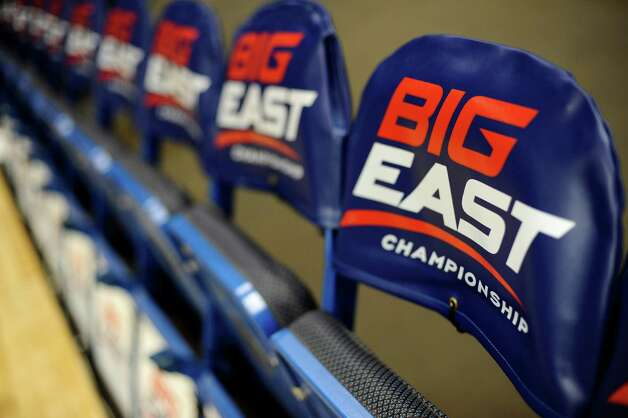 The logo for the Big East Conference is displayed on a row of team chairs at the Big East Conference women's basketball tournament in H