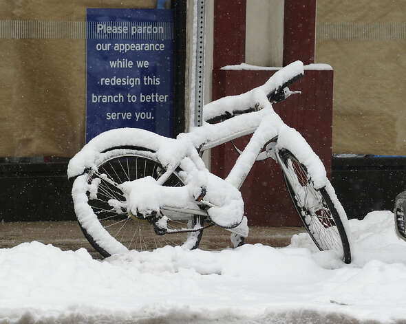 A snow-covered bicycle on Railroad Avenue during the snow storm that hit Greenwich, Friday, March 8, 2013. Photo: Bob Luckey / Greenwich Time