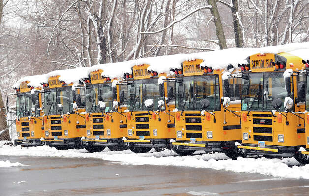 Idle snow-covered school buses in the bus yard off Laddins Rock Road, Old Greenwich, during the snow storm that hit the area, Friday, March 8, 2013. Both Stamford and Greenwich public schools were closed due to the weather. Photo: Bob Luckey / Greenwich Time