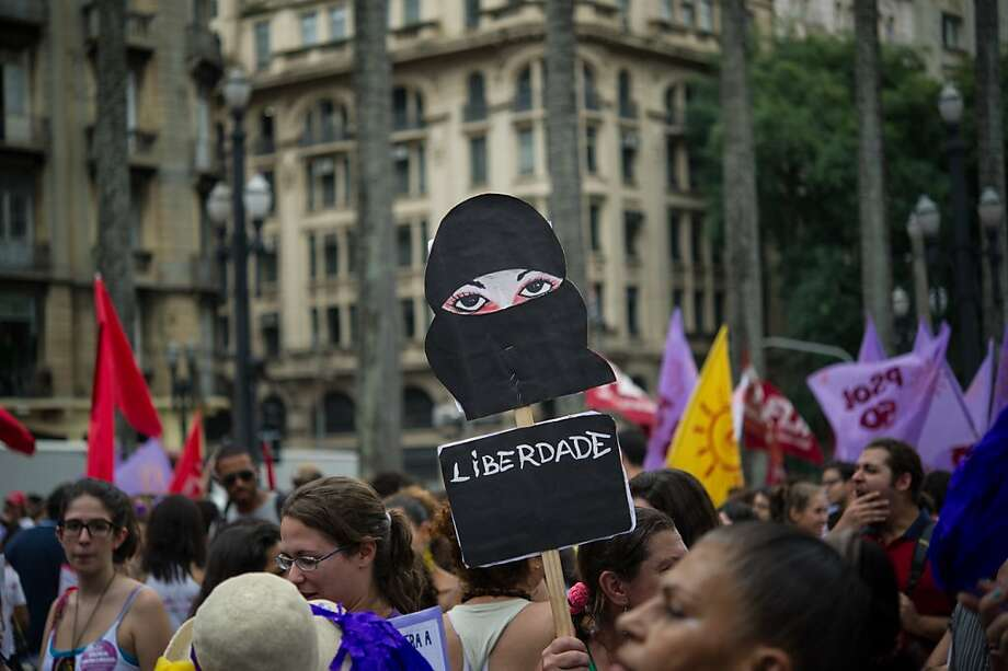 "Women protest against violence against women during the celebration of the International Women's Day on March 8, 2013, in Sao Paulo, Brazil. (The placard reads ""Freedom""). Photo: Yasuyoshi Chiba, AFP/Getty Images"