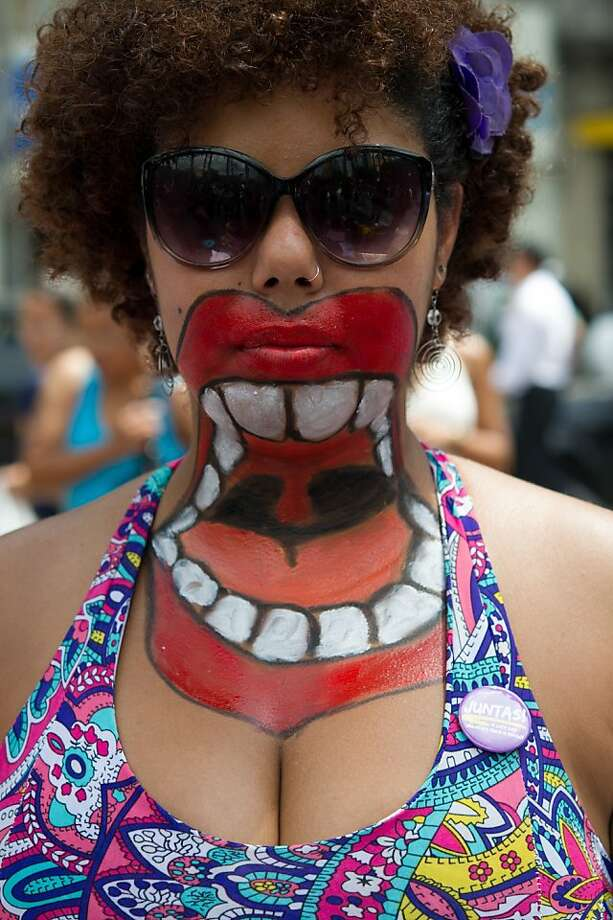 A woman with her upper body painted poses as she takes part in a protest against violence against women during the celebration of the International Women's Day on March 8, 2013, in Sao Paulo, Brazil. Photo: Yasuyoshi Chiba, AFP/Getty Images