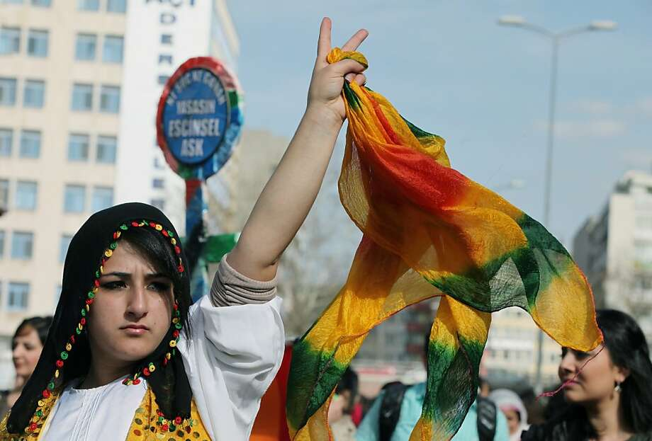 Turkish Kurdish women protest domestic violence against women, war and discrimination as they march to commemorate the International Women's Day in Ankara, Turkey, Friday, March 8, 2013. Photo: Burhan Ozbilici, Associated Press
