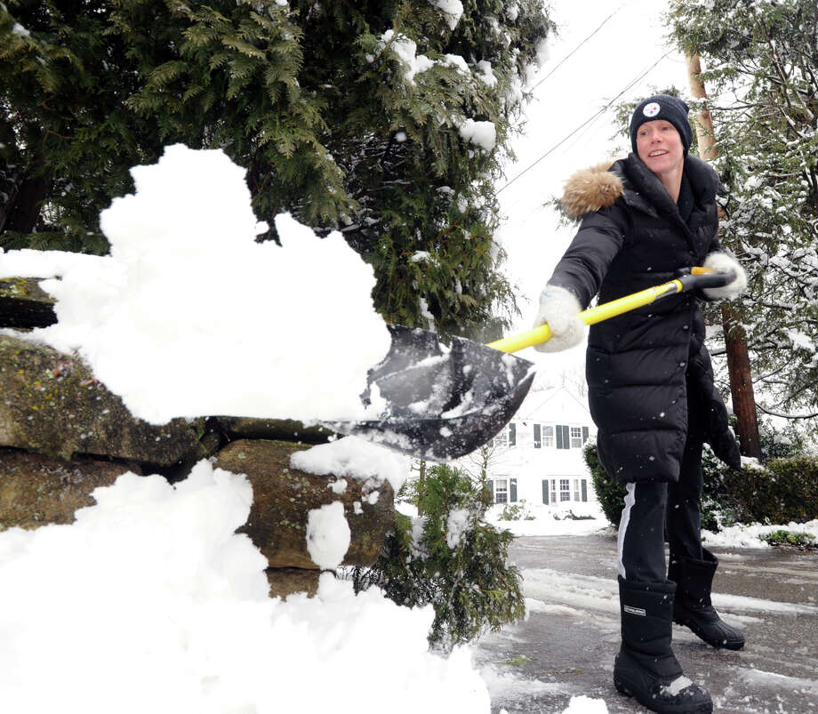 Christine Walker of Riverside shovels her driveway on Lockwood Road during the snow storm that hit Greenwich, Friday, March 8, 2013. Photo: Bob Luckey / Greenwich Time