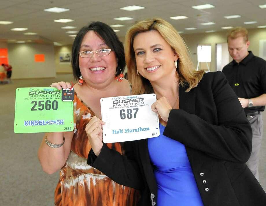 Were you Seen at the Gusher Marathon, Half Marathon, 5K packet pickup? Dave Ryan/The Enterprise