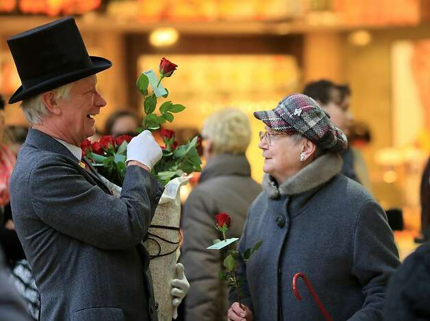 "Self-styled ""Knight of the Rose"" Rolf Schrader offers roses to women in Magdeburg, eastern Germany, on Women's Day, March 8, 2013. The International Women's Day is marked on March 8 every year to pay tribute to women and their achievements. Photo: Jens Wolf, AFP/Getty Images"