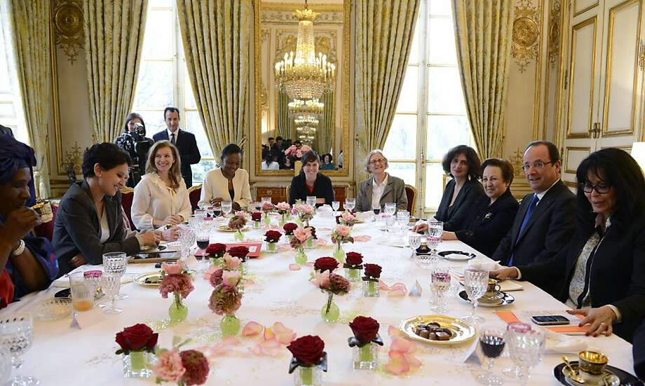 "French president partner Valerie Trierweiler (third from left), Minister for Women's Rights Najat Vallaud-Belkacem (second form left) and Junior minister for Francophony, Yamina Benguigui (right), pose before a lunch with Shirin Ebadi (thrid from right) Iranian lawyer and 2003 Nobel Prize for Peace laureate, Ramata Coulibaly (left) from the ""Malian from France for peace collectif"", and Selma Fekih (center), Tunisian embassador in France's wife. The lunch is held by Trierweiler to mark the Women's international day. Photo: Bertrand Guay, AFP/Getty Images"