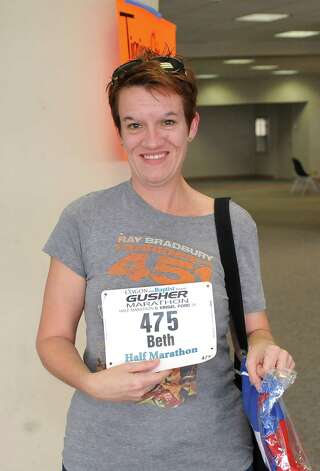 Were you Seen at the Gusher Marathon, Half Marathon, 5K packet pickup? Dave Ryan/The Enterprise