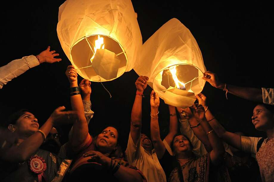 All India Peace and Solidarity Organisation (AIPSO) members launch sky lanterns during International Women's Day in Hyderabad on March 8, 2013. International Women's Day is marked on March 8 every year. Photo: Noah Seelam, AFP/Getty Images