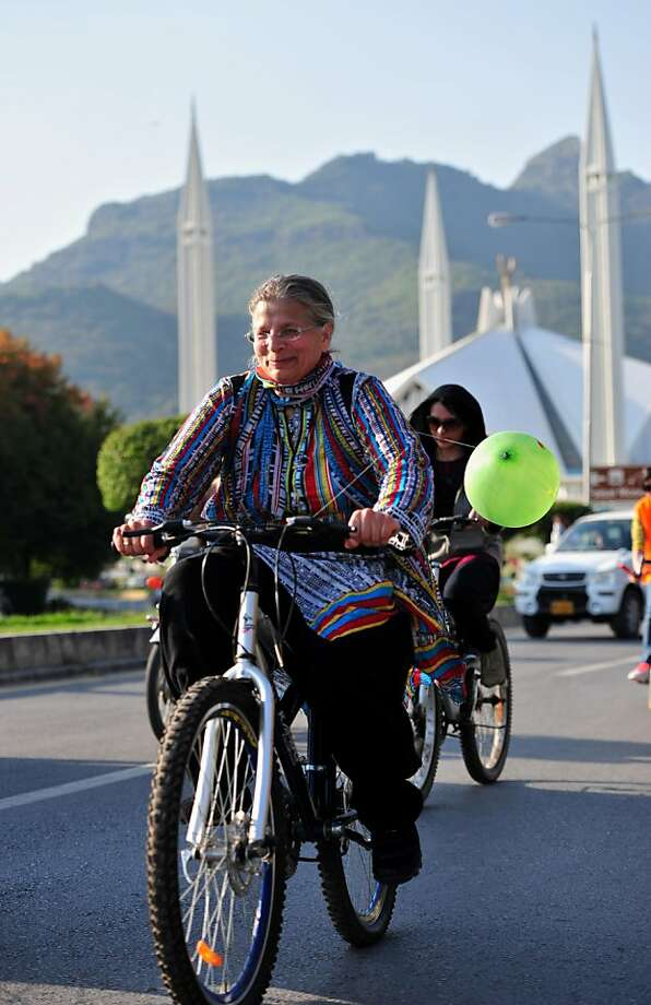 Pakistani women ride their bicycles to mark International Women's day in Islamabad on March 8, 2013.  A group of determined women took to bikes March 8, riding through the Pakistani capital to highlight their rights and love of exercise in a culture that often treats them as second-class citizens. Photo: Farooq Naeem, AFP/Getty Images