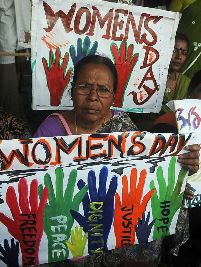 Indian female laborers and sex workers pose with placards for a rally on International World Women's day  in Kolkata on March 8, 2013. The demonstrators participated in the rally to demand equal social and financial rights and security. Photo: Dibyangshu Sarkar, AFP/Getty Images