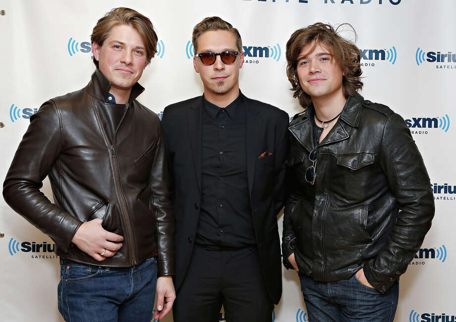 Taylor Hanson, left, (pictured with the other Hansons) is 30 on Thursday. Photo: Cindy Ord, Getty Images / 2013 Cindy Ord