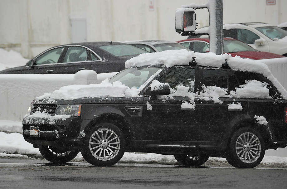 A snow-covered vehicle in the downtown central business district during the snow storm that hit Greenwich, Friday, March 8, 2013. Photo: Bob Luckey / Greenwich Time