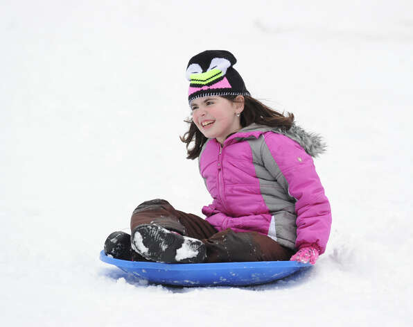 Willow Bobrowitz, 8, of Cos Cob, sledding during the aftermath of the snow storm at Bruce Park in Greenwich, Friday, March 8, 2013. Photo: Bob Luckey / Greenwich Time