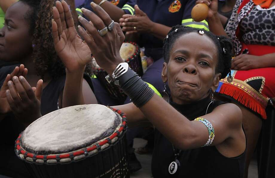 Women take part in a drumming session in downtown Johannesburg, Friday, March 8, 2013 to protest against violence against women and children. As the world marks International Women's Day, South Africans are locked in public soul-searching over the high level of murders and rapes perpetrated against women. Photo: Denis Farrell, Associated Press